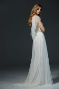 o-Caccini-wedding-dress-beaded-dress-model-facing-sideways-arms-crossed-glance-back